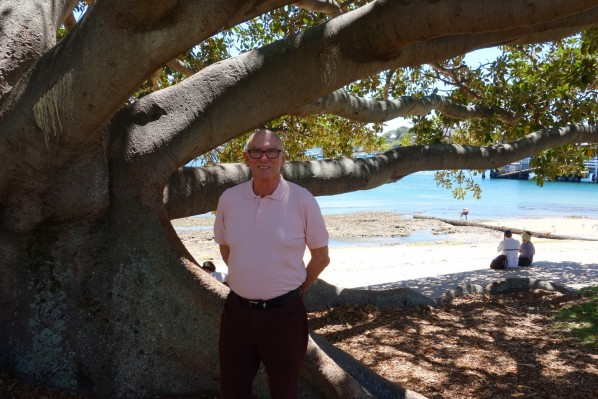 Michael under the large canopy of the Moreton Bay Fig tree at Watson's Bay