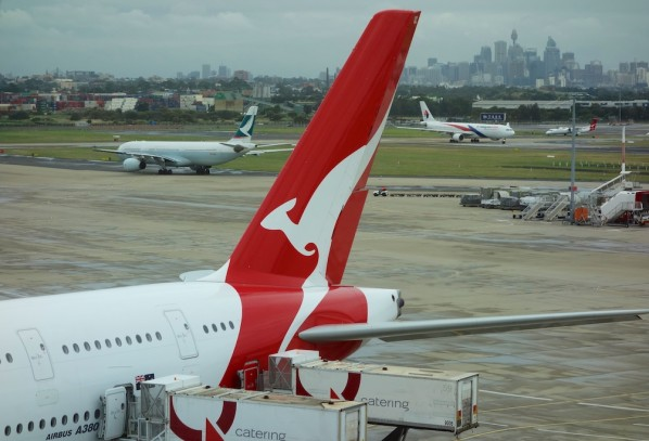 Qantas A380 ready for takeoff to Dubai with City of Sydney in the background