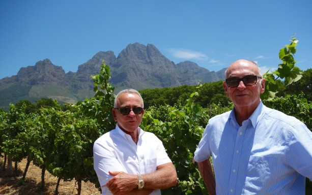 Edmundo and Michael at Boschendal Winery with Simonsberg Mountains as a backdrop near Franschhoek, outside Cape Town