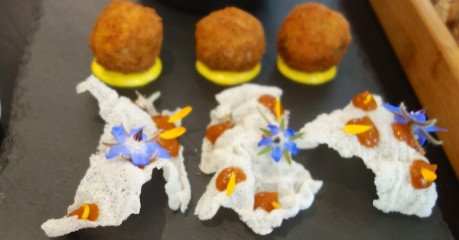 Amuse-bouche - Crisp tapioca and edible flowers and Cod bacalhau balls