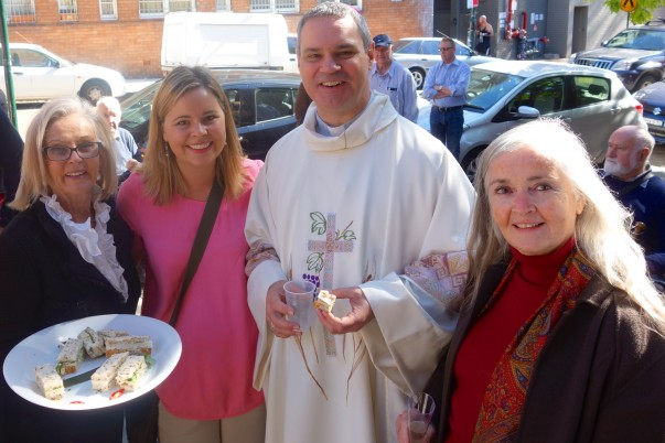 'Bishop Peter' chats and shares a chicken sandwich with Elouise and June