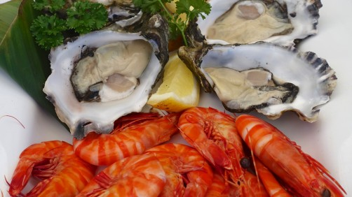Freshly shucked local oysters and tiger prawns