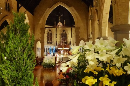 The church was decorated this year with a dozen Cypress Pines and beautiful flowers in yellow and white.