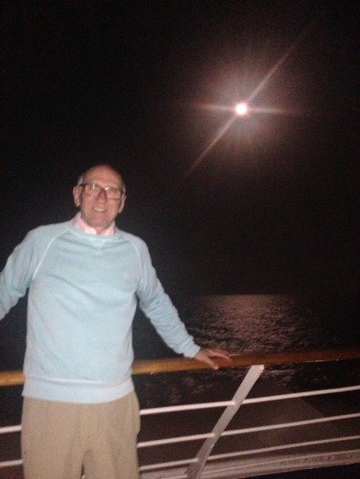Michael (with belt) by the light of the Easter Moon - on deck in the Gulf of Oman as we sail towards our final destination, Muscat