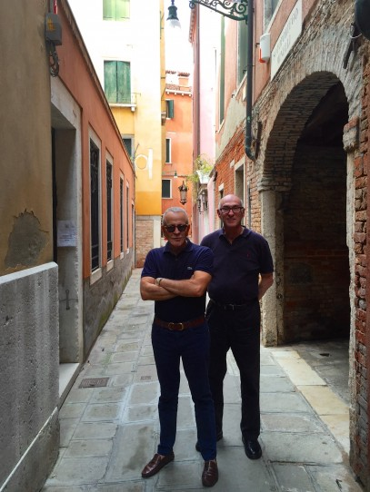 Men in black - in a Venetian laneway near The Fenice