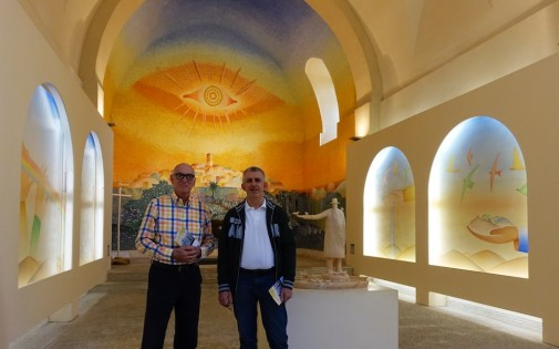 Michael and Agostino wander into La Chapelle des Pénitents Blancs, decorated by Belgian artist Folon. It exudes such light and an instant sense of peace.