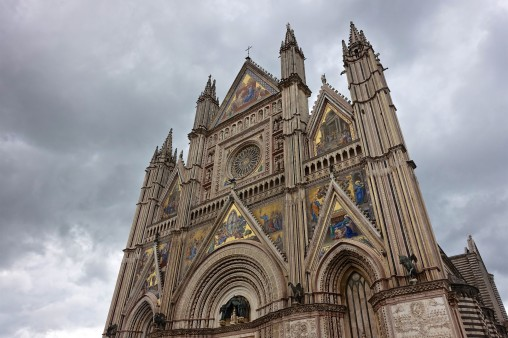 Golden mosaics adorn the facade of the 14th century Cathedral of Orvieto