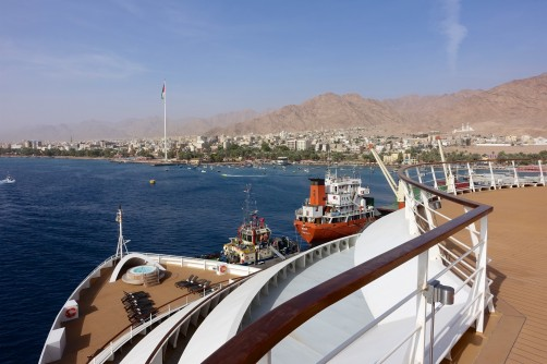 Tugs assist in the docking of Seabourn Sojourn in Aqaba, Jordan