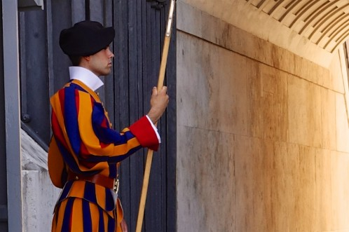 Colourful Swiss Guard at the Vatican in traditional uniform at the Vatican