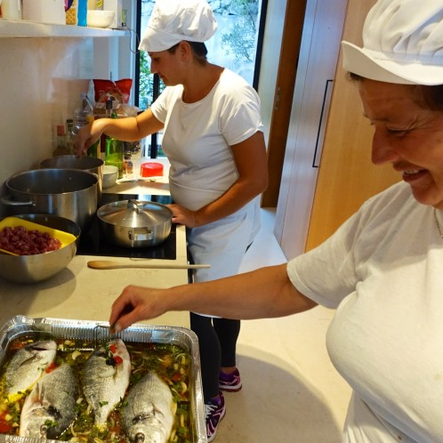 Mama Margeurite and Isabella prepare the 'fish in crazy water' for the dinner on our last night