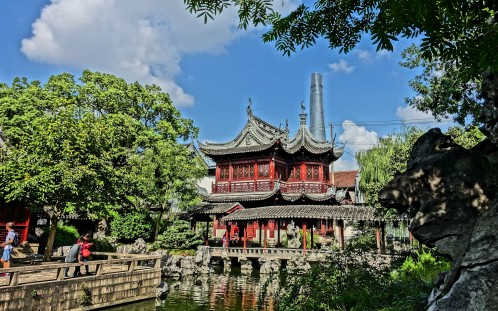 Old and modern Shanghai - Ming Dynasty-era pavilions in Yu Garden - with Shanghai's megatall skyscraper in the distance