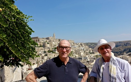 Michael and Paul with the Sassi area of Matera behind us. The plant on my left is capers - growing out of rocks all over the area.