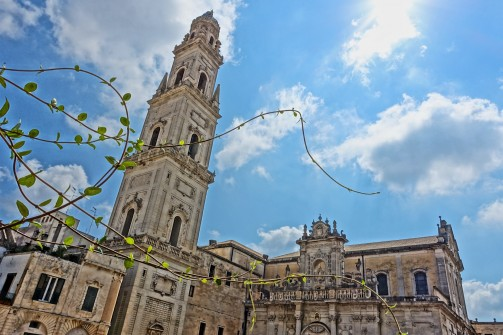 In Piazza del Duomo in Lecce, alongside a tall, tapering bell tower, the city's 17th-century highly-chiseled Baroque edifice - the Duomo with a Greek marble altar decorated with lapis lazuli.