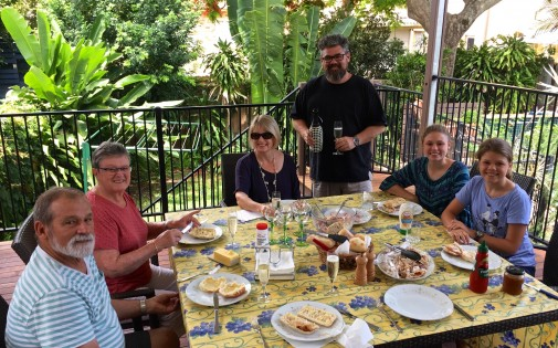 Enjoying lunch al fresco on my sister Anne Schramm 's pool terrace on the Gold Coast. Nephew Mark Schramm and family came down from Brisbane to join us.