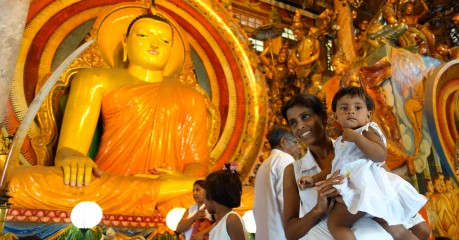 We take a tuk-tuk ride to the Gungaramaya Temple to see preparations for the big Buddhist Festival Parade