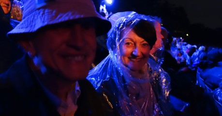 The novelty of sitting in teeming rain hasn't worn off yet for Pam and Ken