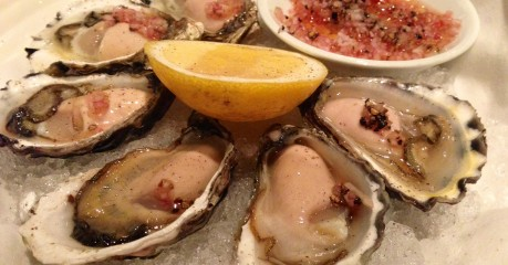 Oysters a la natural tonight were plump and creamy, as of old, even with the buttered thin slices of brown bread.