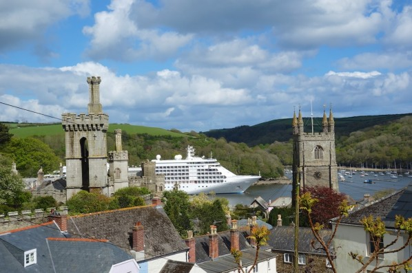 Silver Whisper at anchor in Fowey Harbour, Cornwall, between church, castle and chimneystacks