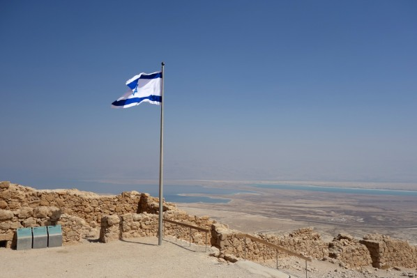 Looking out to the Dead Sea from King Herod's fortified Palace of Masada - In Palestine. Why Israeli flag?