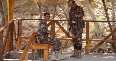 'Tea for two' - Jordanian soldiers across the River Jordan at the spot where John baptised Jesus