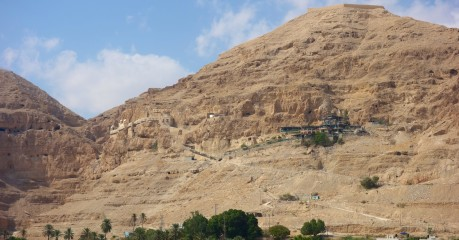 'Mount of Temptation' above Jericho, and Greek Orthodox Monastery of Temptation nestling up near the top of the cliff