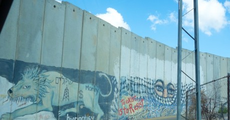 "The graffiti on the Palestinian side of the Separation Wall reads, ""To exist is to resist""."