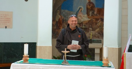 A Franciscan priest leading the singing of Polish Pilgrims at the Tent' church in Shepherds' Field